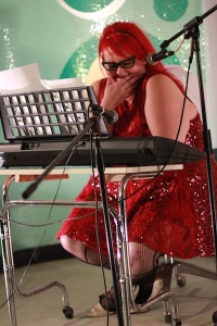 Photo: Being fat with red hair and cateye glasses and wearing an ASOS Curve red lace and sequin dress at Salonathon at Beauty Bar Chicago. Photo source: Google Images, Molly FitzMaurice