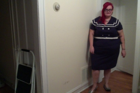 Photo: A fat white woman with long red hair wearing a navy sailor dress. Google Images.