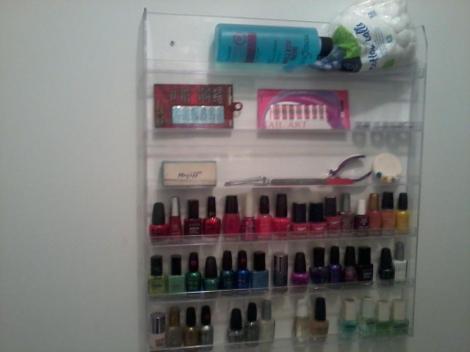 Photo: Salon nail polish organizer with the polishes in rainbow order.