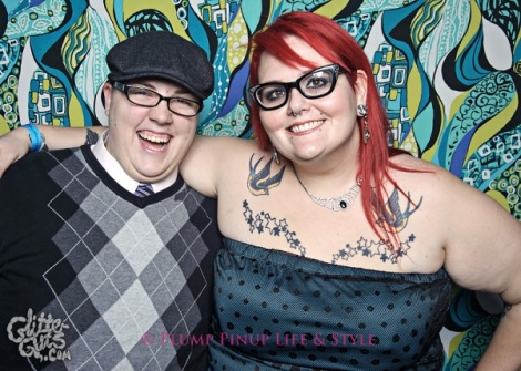 Photo: A white butch and redheaded fat femme pose at FKA NYE at Bottom Lounge. Photo source: Google Images, Glitter Guts
