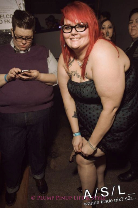 Photo: A fat white femme woman adjusting her Cuban heel stockings at FKA NYE at Bottom Lounge. Image Source: Google Images, ASL Media