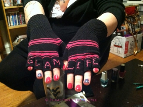"""Photo: A woman's hands wearing black fingerless gloves with """"Glam life"""" embroidered on them as knuckle tattoos. Photo source: Google Images, Beelisty"""