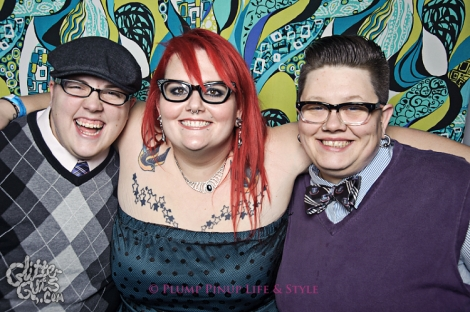 Photo: Two white dandy butches posing with a red headed fat femme at FKA NYE. Image source: Google Images, Glitter Guts