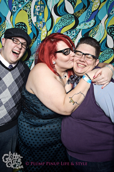 Photo: Two white butches pose with a fancy femme while she kisses on them at FKA NYE at Bottom Lounge. Photo source: Google Images, Glitter Guts
