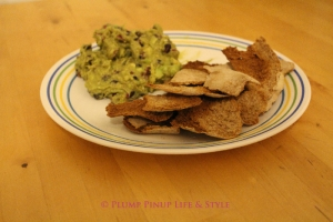 Photo: Pomegranate guacamole with pita chips fanned on a plate. Photo source: Google Images, Plump Pinup