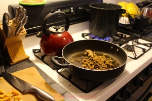Photo: Pasta boiling on a stove with seitan cooking in a skillet. Photo source: Google Images