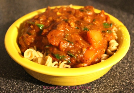 Photo: Hearty vegan pasta sauce over rotini. Photo source: Google Images