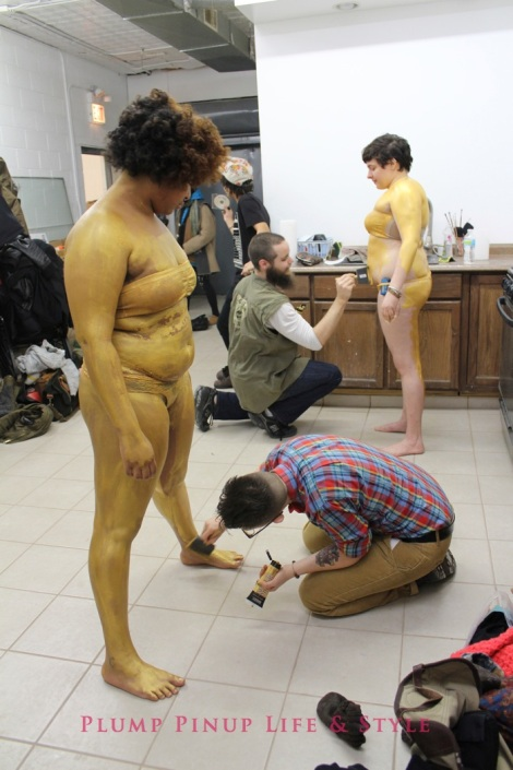 Photo: So Very Alive: Performing Feminist and Queer Utopias, Futures and Dreams at Rumble Arts Center. Image Source: Google Images 1 Body painting AMINA ROSS AND ALLISON SHYER gold back stage