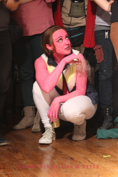 Photo: So Very Alive: Performing Feminist and Queer Utopias, Futures and Dreams at Rumble Arts Center. Image Source: Google Images 10 pink centaur squatting while watching performance Amber Marsh