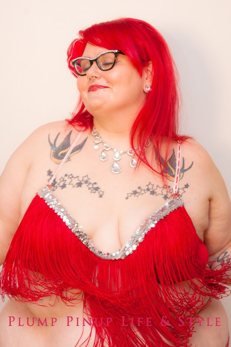 Photo: Plump Pinup Vintage & Couturier line of fat and body positive bras red fringe bra and shimmy belt burlesque costume headshot 1 Photo source: Google Images, Kriss Abigail Photography
